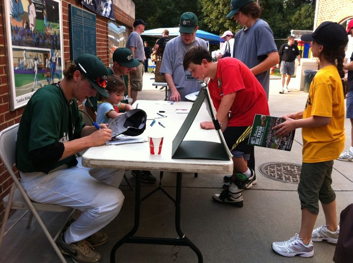 Kaitlyn Signing Autographs at the Bethesda Big Train Baseball Game